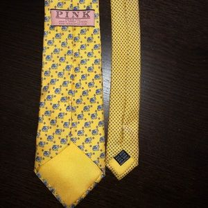 Tie from PINK. Yellow with blue elephants.